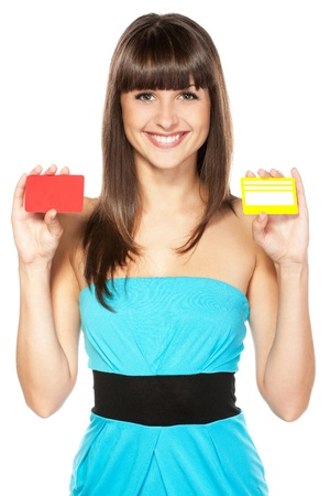 credit card payment: Happy female holding two plastic cards isolated on white background