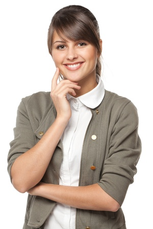 Portrait of young smiling female standing with folded hands, over white background photo