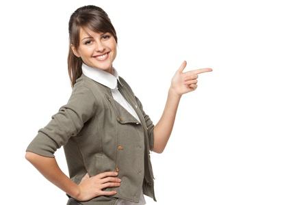 Mujer de negocios hermosa morena señalando copia espacio sobre fondo blanco Foto de archivo