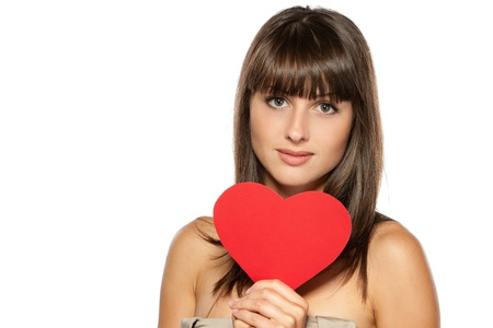 Closeup portrait of young female holding heart shape isolated on white background, with copy-space Stock Photo - 15531259