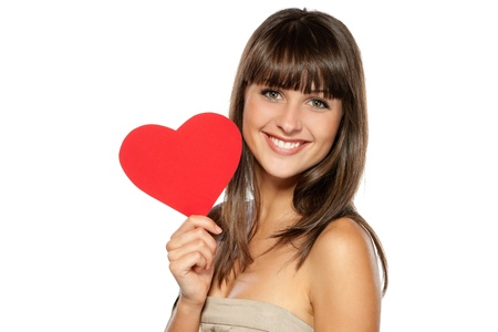 Closeup portrait of young female holding heart shape isolated on white background, with copy-space photo