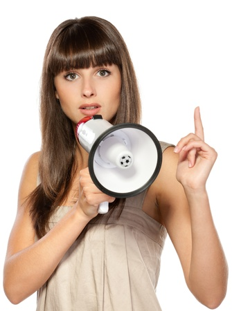 Portrait of beautiful female proclaiming through the loudspeaker, isolated on white background Stock Photo - 15531276