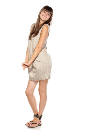 Full length of young charming female in summer dress posing over white background Stock Photo - 15531237