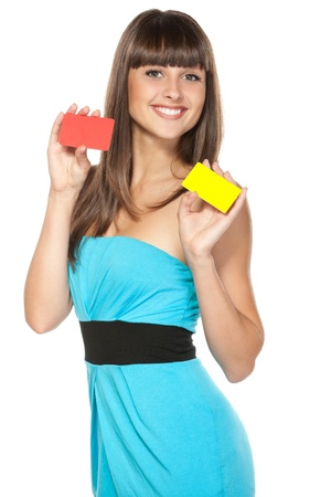 Happy female holding two plastic cards isolated on white background