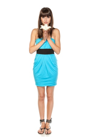 Full length of young charming female in sundress holding white lily over white background Stock Photo - 15531238