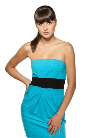 Young female in turquoise cocktail dress posing on white background Stock Photo - 15531269