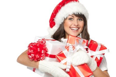 Christmas shopping woman holding gifts wearing red Santa hat   Stock Photo