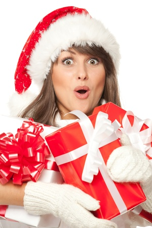 widely: Closeup of a girl in Santa hat, surprised by having received a lot of Xmas presents, over white background