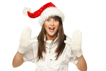 Enthusiastic girl in Santa hat shouting Xmas news, isolated on white bachglound