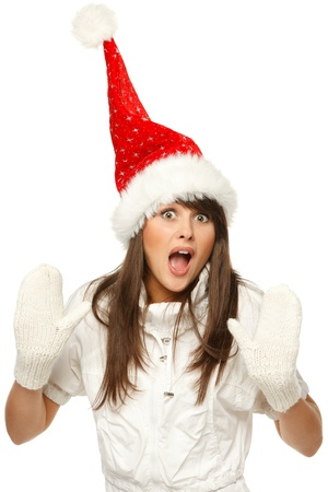 Funny image of a girl in red santa hat shocked and surprised, isolated on white background photo