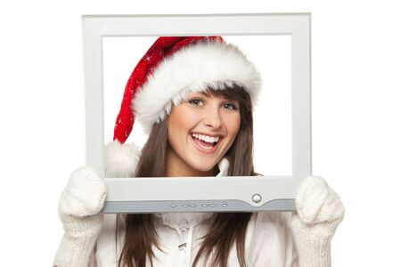 Laughing girl in Santa hat broadcasting Christmas news from TV   computer screen, isolated on white background  Christmas news  photo