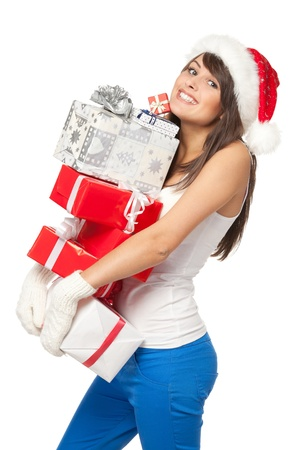 Christmas shopping woman with funny expression holding many gift boxes over white background