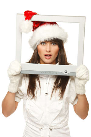 Surprised beautiful girl in Santa hat broadcasting Christmas news through TV   computer screen, isolated on white background  Christmas news  photo