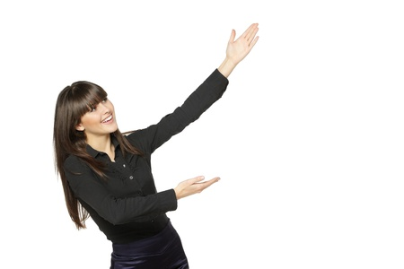 looking sideways: Portrait of young smiling business woman showing the blank copy space over white background Stock Photo