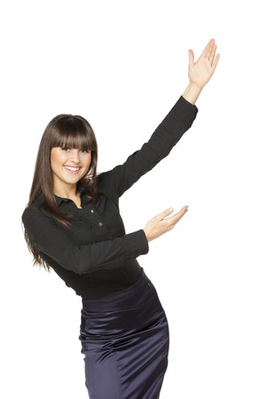 sideways: Portrait of young smiling business woman showing the blank copy space over white background Stock Photo