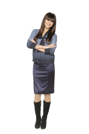 folded hands: Full length portrait of relaxed young businesswoman standing with hands folded on white background Stock Photo