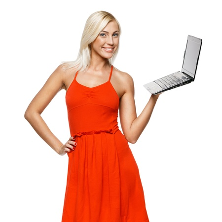 sundress: Portrait of a pretty young woman holding a laptop on a white background Stock Photo