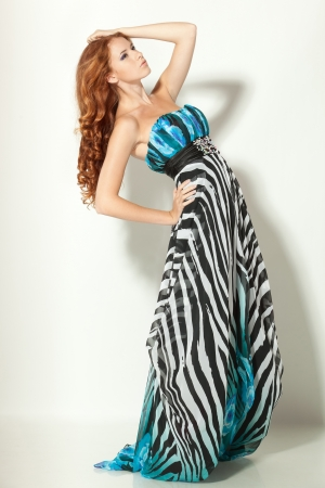 Full length of beautiful red-haired fashion model posing photo