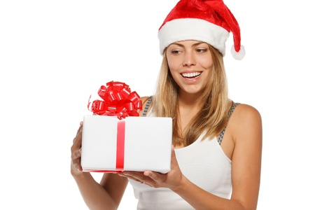 Happy woman in Santa hat holding a Xmas gift, isolated on white background Stock Photo - 16031215