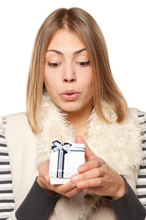 Close up of surprised girl opening the gift box over white background Stock Photo - 16031345