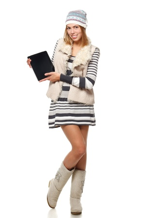 Full length of young winter female holding tablet computer with blank copy space over white background Stock Photo - 16031207