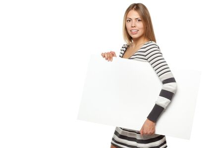 Young female in winter dress carrying a blank billboard, isolated on white background photo