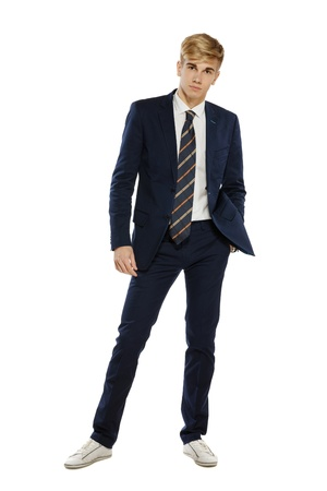 Full length portrait of a stylish young man standing with hand in pocket over white background Stock Photo - 16031770