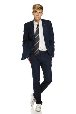 Full length portrait of a stylish young man standing posing over white background Stock Photo - 16031977