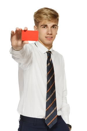Young business man showing a blank business card over white background Stock Photo - 16031963