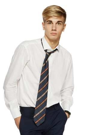 Portrait of handsome young man in shirt and tie, over white background