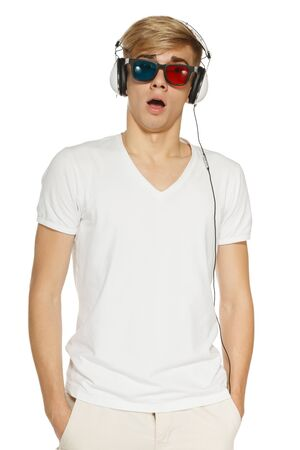 astonished: Surprised man in three-dimensional glasses and headphones, over white background