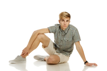 shoe model: Casually dressed man sitting on the floor