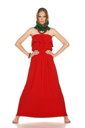 Full length of young brunette lady in long red dress posing on white background with a russian style headscarf over head