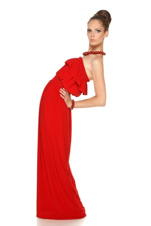 Full length of young lady in long red dress posing on white background photo