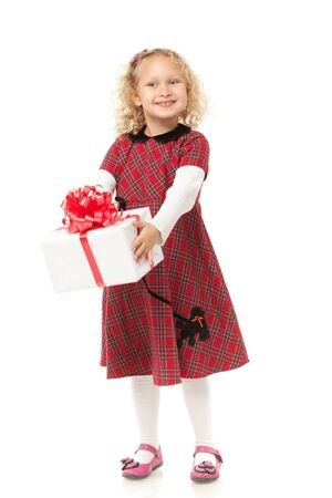 alone person: Full length of little girl holding her Christmas present, over white background