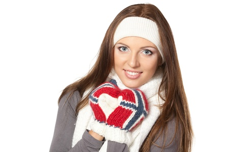 Closeup of a girl in warm clothing, over white background photo