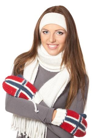 Cheerful woman clothing in warm scarf, gloves and headband hat  Winter season  photo