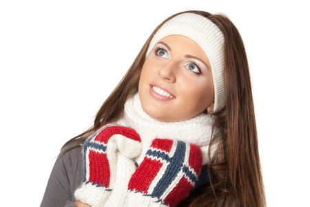 upwards: Closeup of a girl in warm clothing looking upwards, over white background