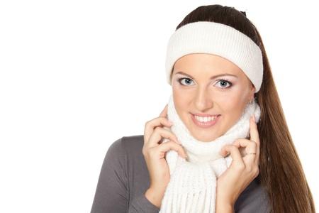 Closeup of cheerful woman clothing in warm scarf and headband  Winter season  photo