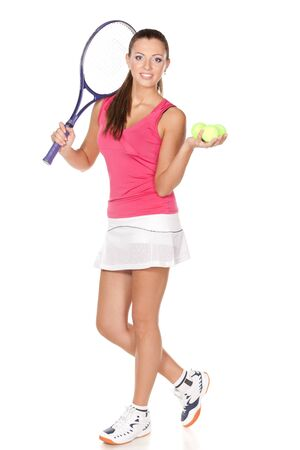 Full length of young woman holding racket and ball isolated on white background photo