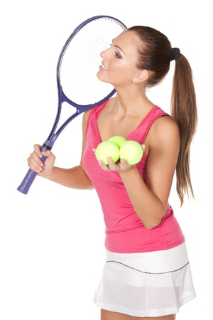 Yyoung woman holding tennis racket and ball looking sideways isolated on white background photo