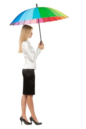Full length, side view of young business woman holding an umbrella over white background photo