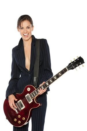 Young female in suit playing electric guitar isolated on white background photo