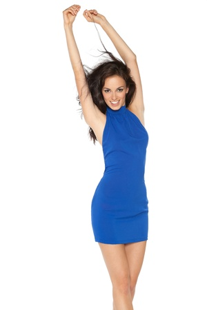 Beautiful female fashion model in blue dress posing streching herself over white background Stock Photo - 16686754