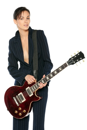 glam rock: Young female in suit playing electric guitar isolated on white backgroun Stock Photo