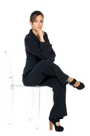 arms on chair: Young business woman sitting on the transparent chair, isolated on white background Stock Photo