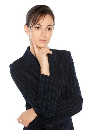 Portrait of young thinking businesswoman in suit, looking down, isolated on white background photo