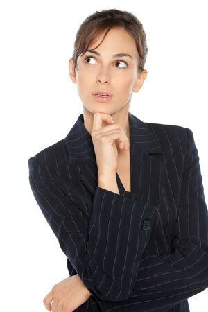 looking upwards: Young pensive business woman looking upwards over white background