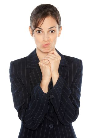 resentment: Portrait of business woman making a silly face over white background
