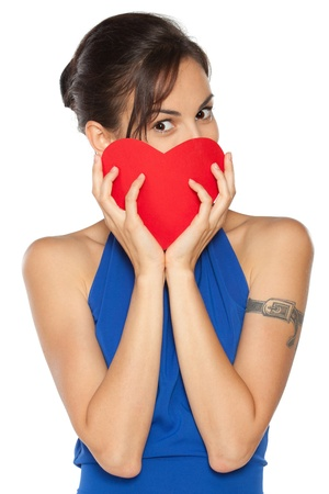 Young beautiful female in blue dress peeking from the heart shape isolated on white background Stock Photo - 16713983